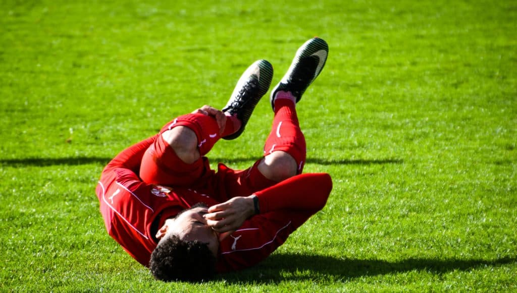 adult athlete cramps 460550 1024x581 - Muscle Cramps or Muscle Spasms?